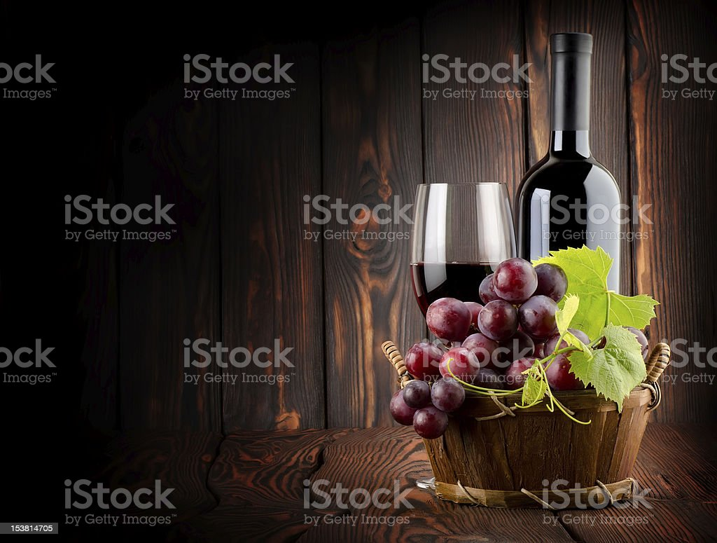 Wine on the old wooden background stock photo