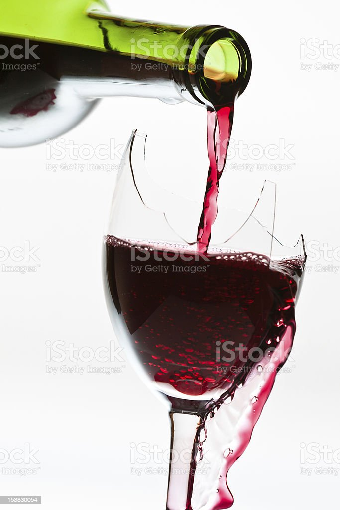 Wine overflow in the broken glass stock photo