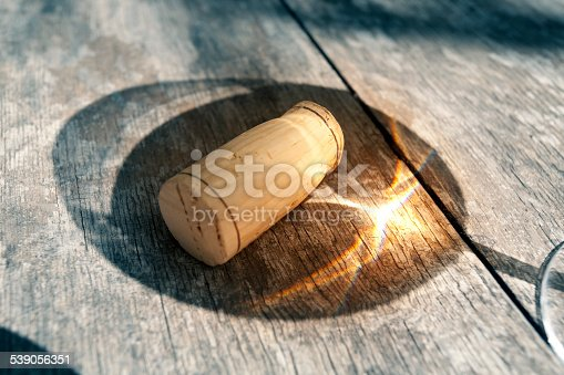 Shadow of a glass of wine with cork.