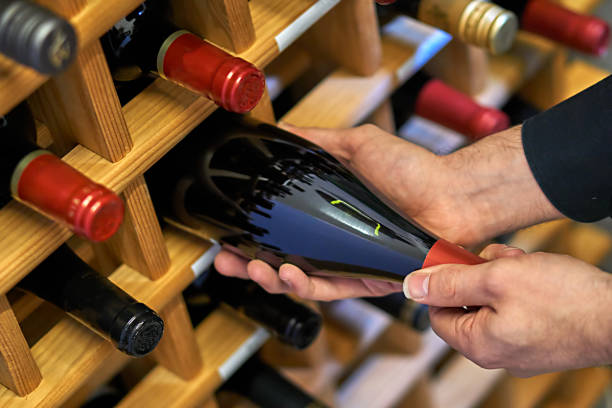 Wine Wine bottles in a wooden shelf wine cellar stock pictures, royalty-free photos & images
