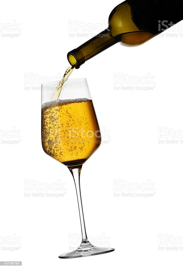 Wine pouring in glass isolated on white background royalty-free stock photo