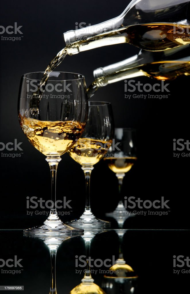 Wine Pouring into Glasses royalty-free stock photo