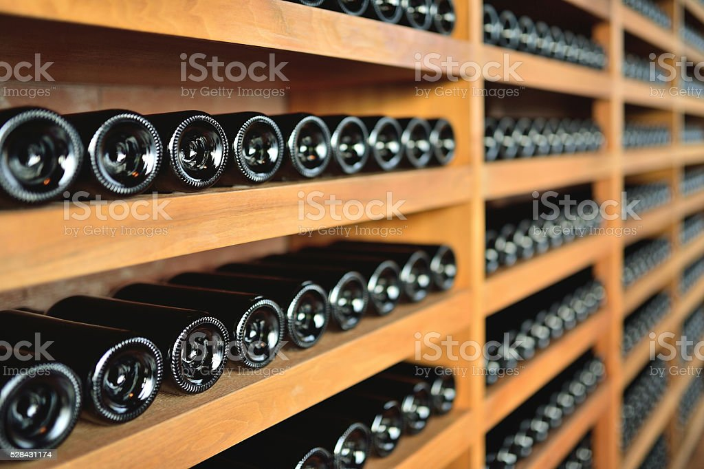 Wine rack and Wine bottles stock photo