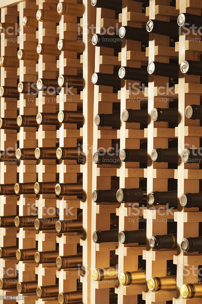 Wine Rack Filled with Bottles Vertical royalty-free stock photo