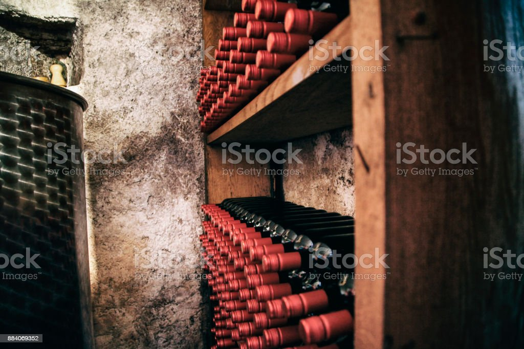 Wine rack with bottles of red wine stock photo