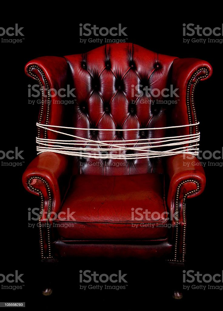 Wine red leather chair with bondage rope stock photo
