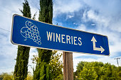 Vineyard signpost and directions to grape crops