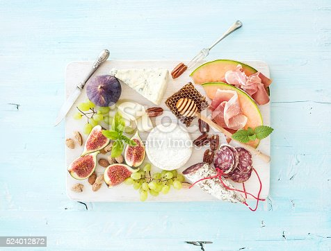 istock Wine snack set. Figs, grapes, nuts, cheese variety, meat appetizers 524012872