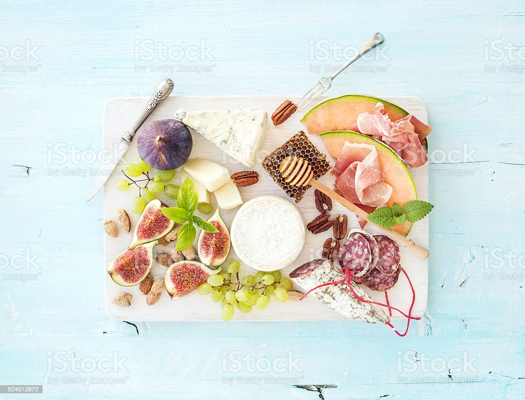 Wine snack set. Figs, grapes, nuts, cheese variety, meat appetizers stock photo