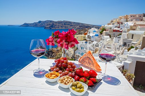 istock Wine, snacks and fruit on the table 1254433195