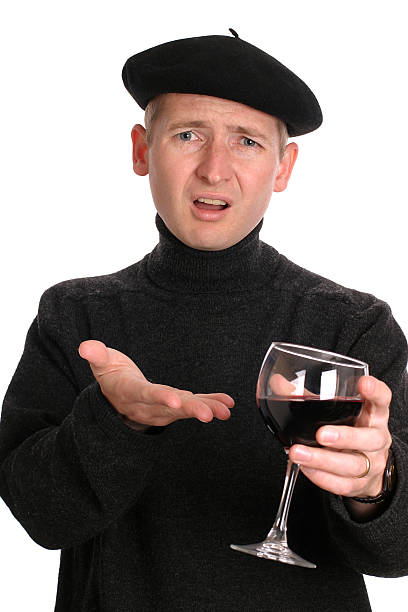 Wine snob wearing beret and gesturing with wine glass stock photo