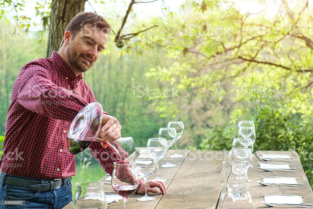 wine taster and wine glasses on a wooden table stock photo