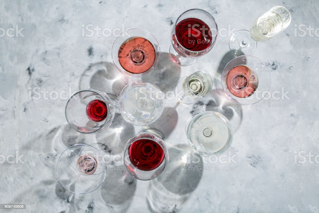 Wine tasting concept - glass with different wine on marble background stock photo