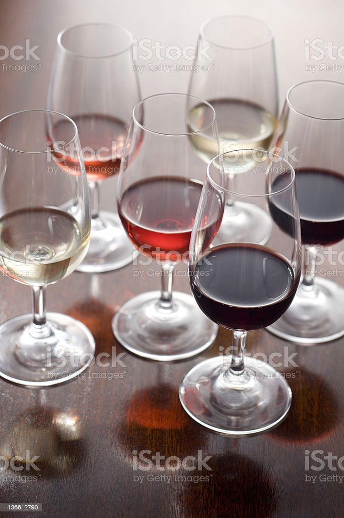 Wine tasting glasses poured with three types of wine royalty-free stock photo