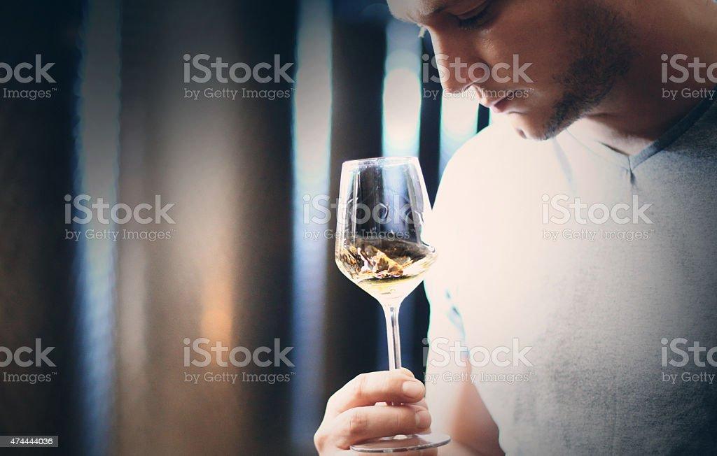 Wine tasting in wine cellar. stock photo