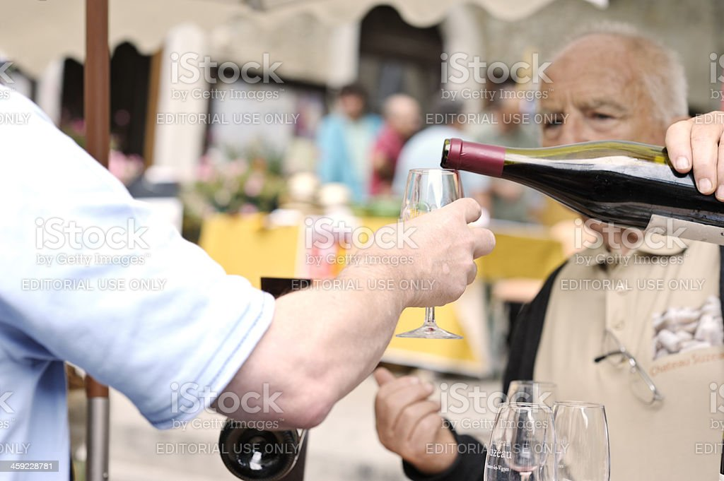 Wine tasting on French market stall royalty-free stock photo