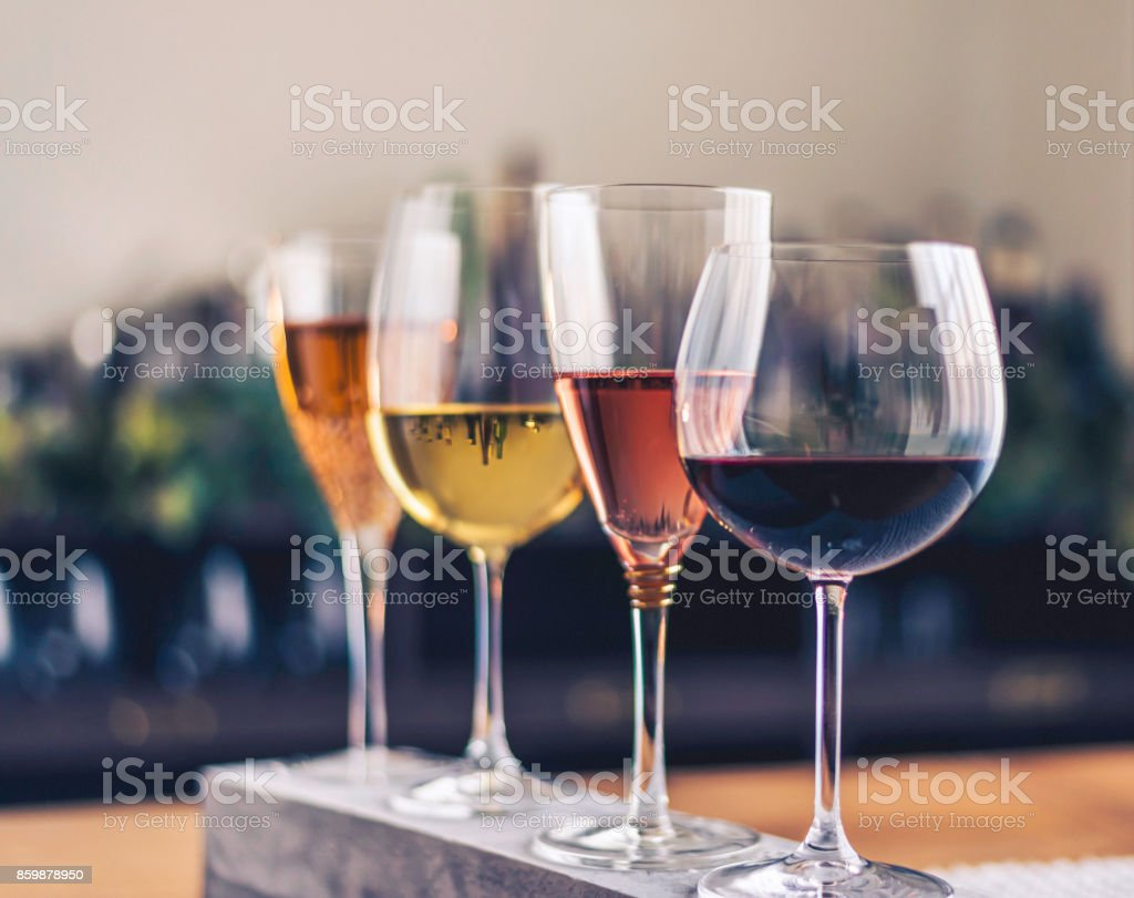 Wine tasting theme with four glasses of wine stock photo
