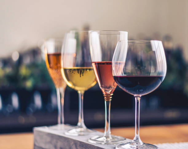 Wine tasting theme with four glasses of wine Wine tasting theme with four glasses of wine winetasting stock pictures, royalty-free photos & images
