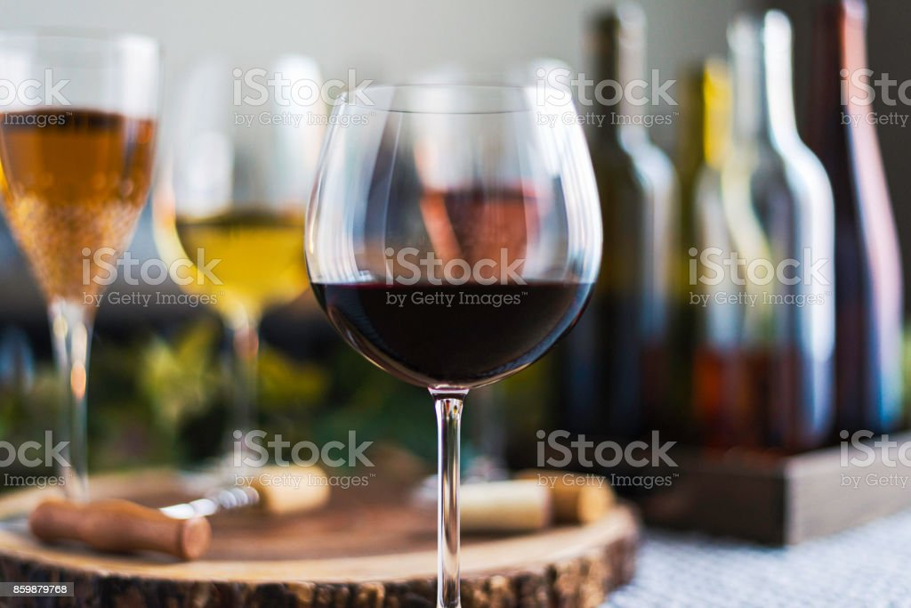 Wine tasting theme with various bottles of wine and glasses stock photo