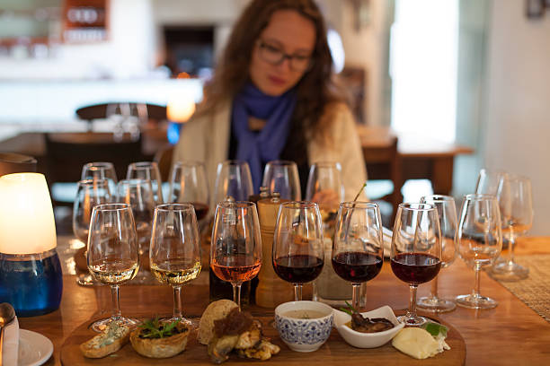 Wine tasting with food accompanied by a beautiful girl The picture is set in South Africa's wine country in the Western Cape. A wine tasting partnered with a food sampling is quite popular amongst tourists.  western cape province stock pictures, royalty-free photos & images