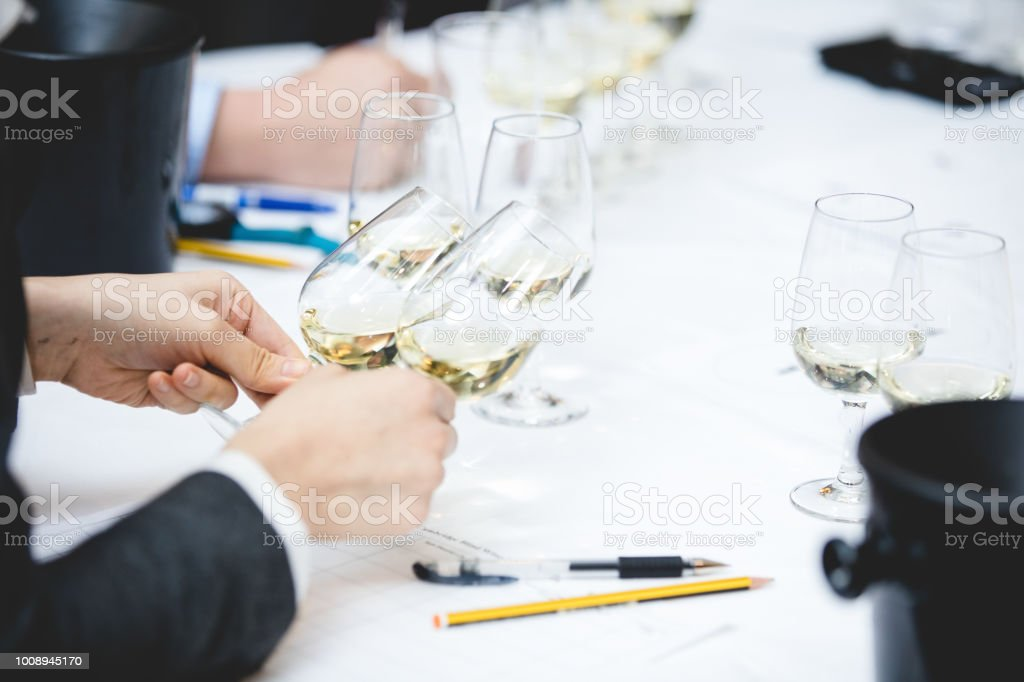 Wine tasting, with human hands, unrecognizable person
