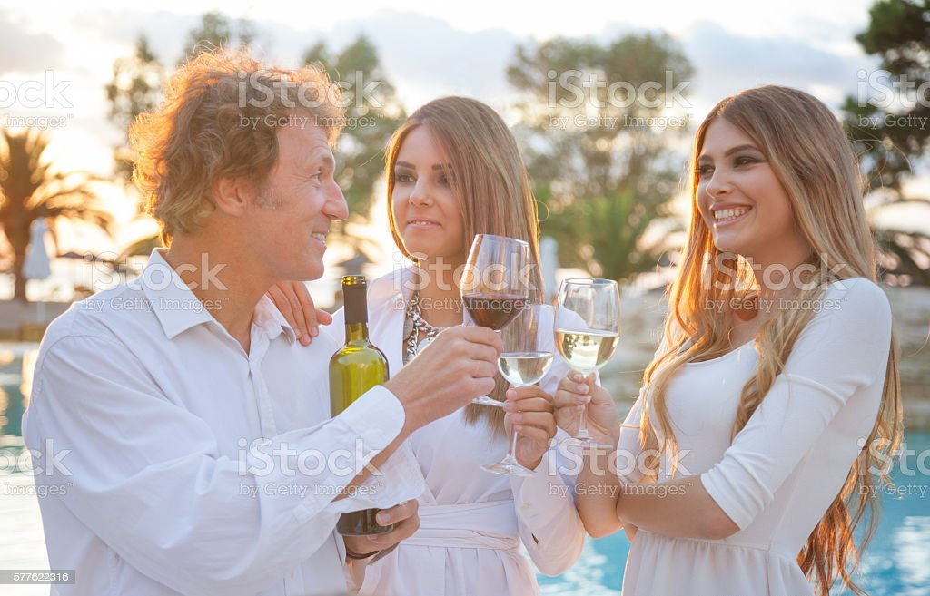 Wine toast at a party stock photo
