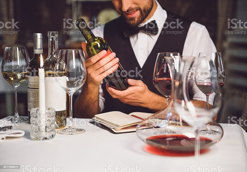 Wine variety in hands of sommelier stock photo