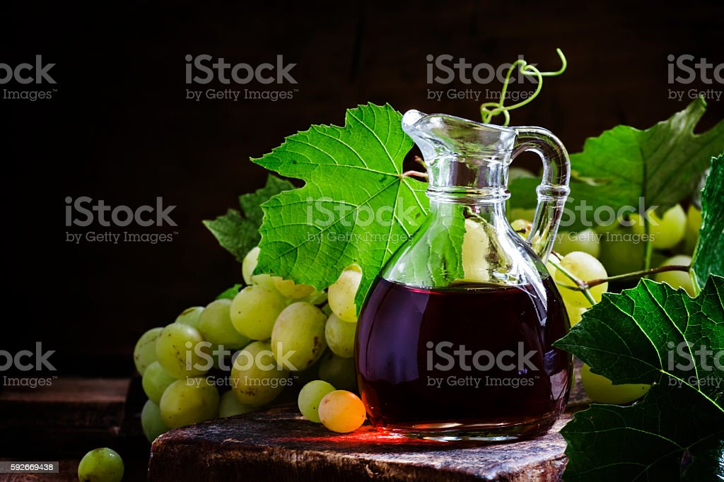 Wine vinegar in a glass jug stock photo