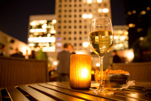 wine with candle and buildings stock photo