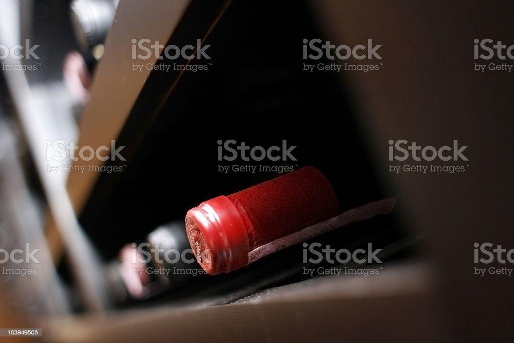Wine-Cellar: Dusty Wine Bottles Aging on a Rack stock photo