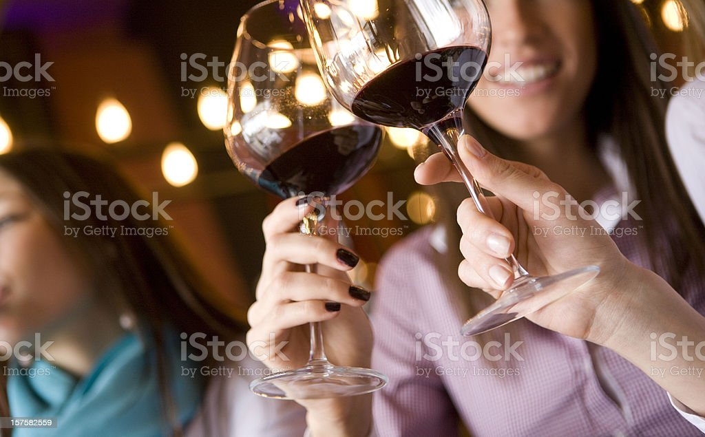 Wineglass in hand with wine stock photo
