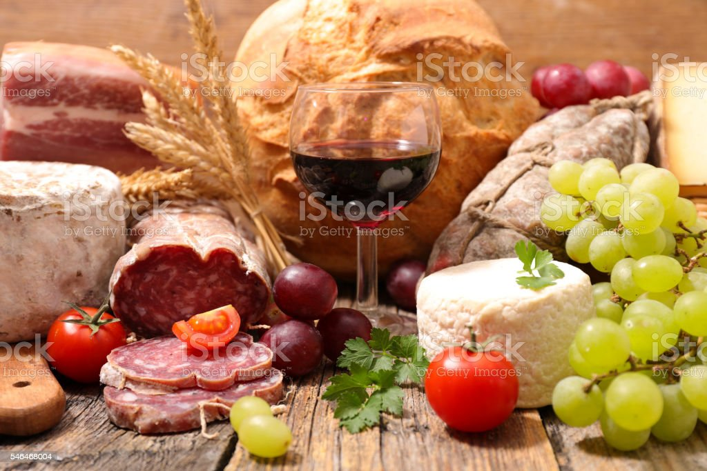 wineglass with cheese and salami stock photo