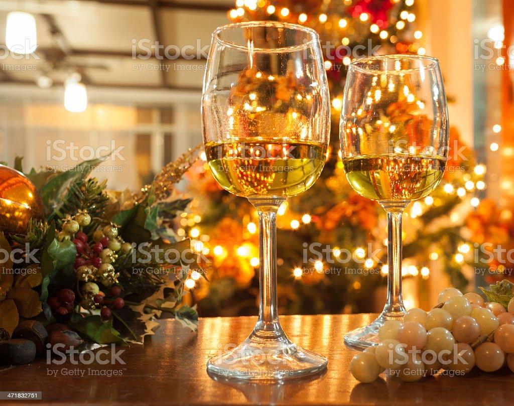 Wineglasses against Christmas Lights stock photo