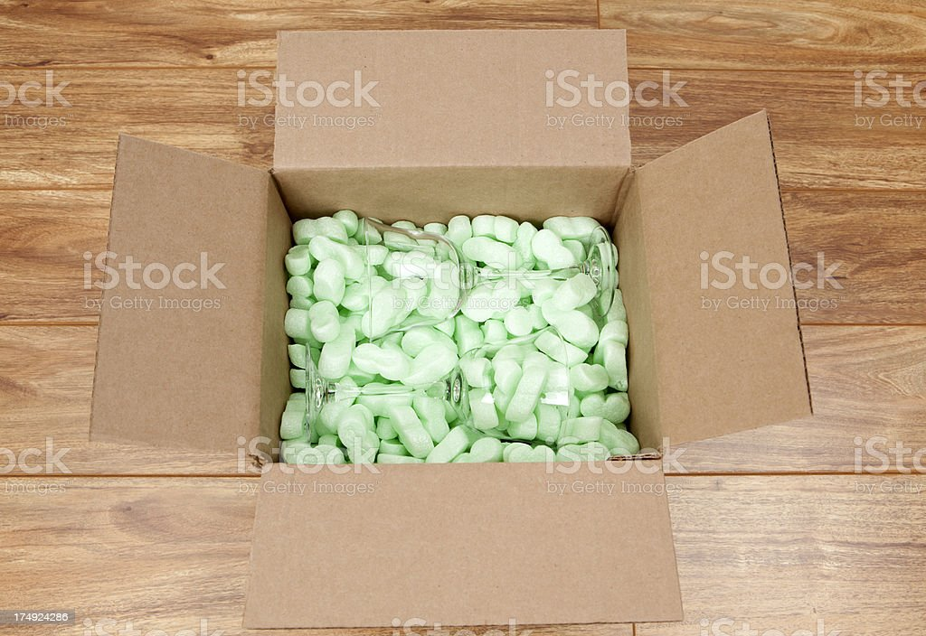 Wineglasses and Packing Peanuts in Cardboard Box stock photo