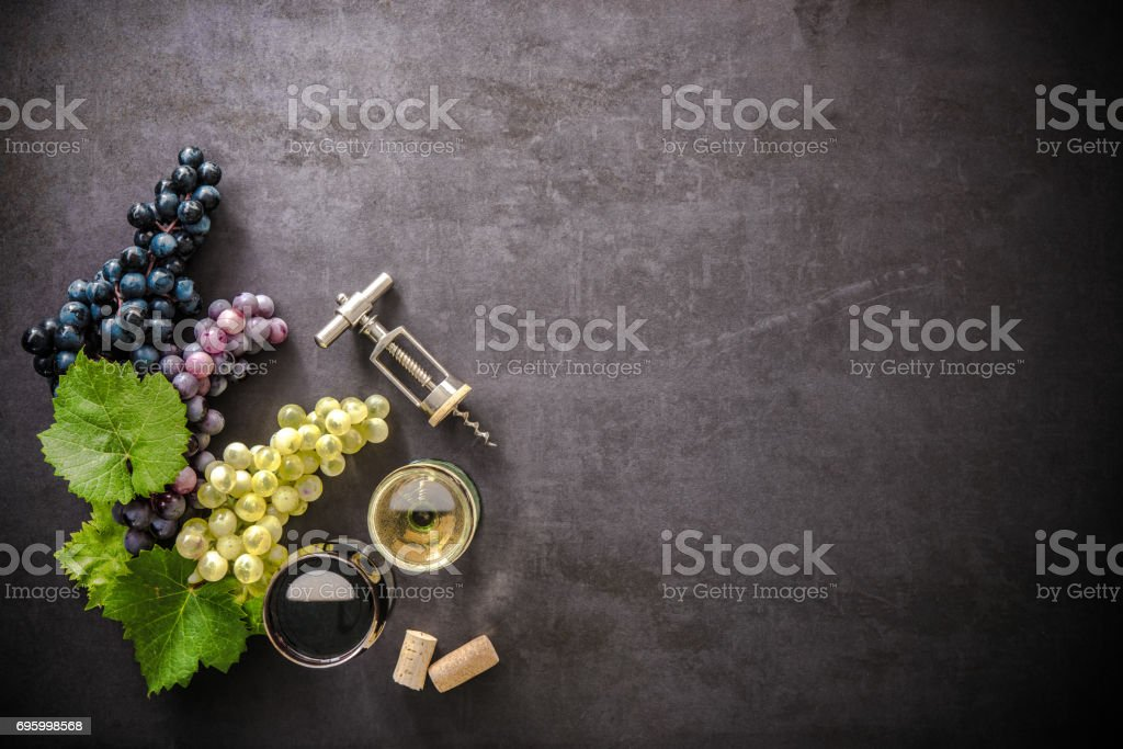Wineglasses with grapes and corks stock photo
