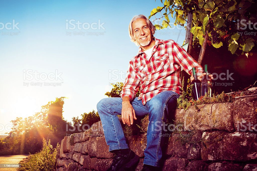 winemaker sitting by his vineyard royalty-free stock photo