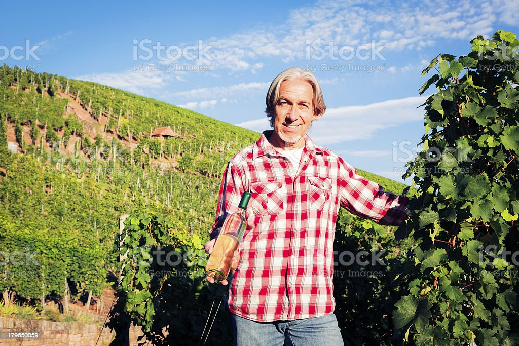 winemaker standing by his vineyard royalty-free stock photo