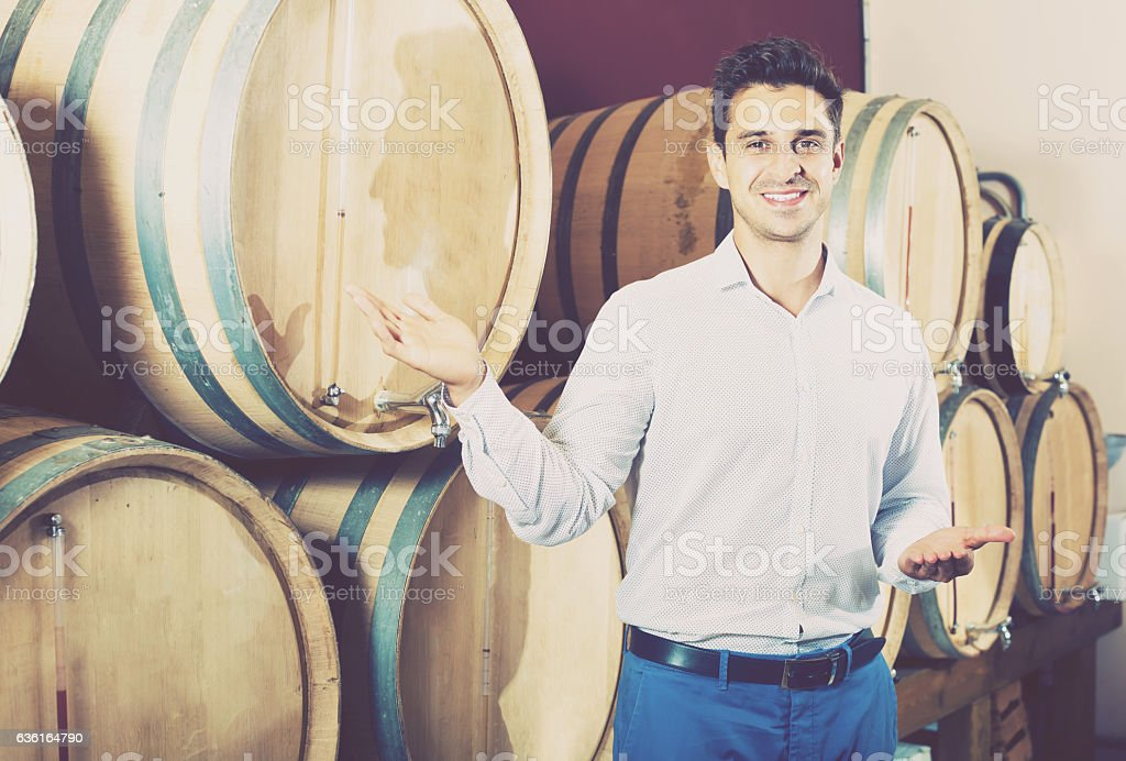 Winery owner standing in shop stock photo