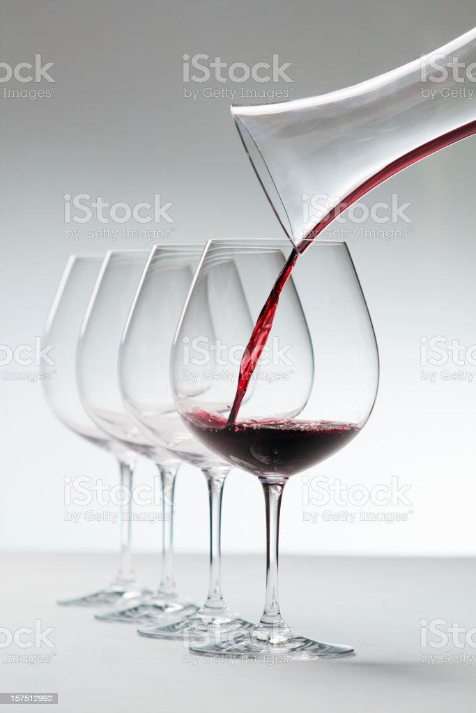 Winetasting- Pouring Red Wine stock photo