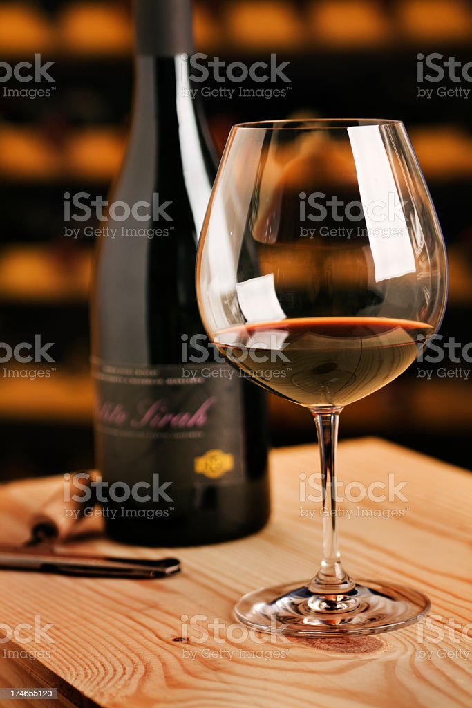 Winetasting Red Wine Glass, Bottle and Corkscrew for Cellar Tasting royalty-free stock photo