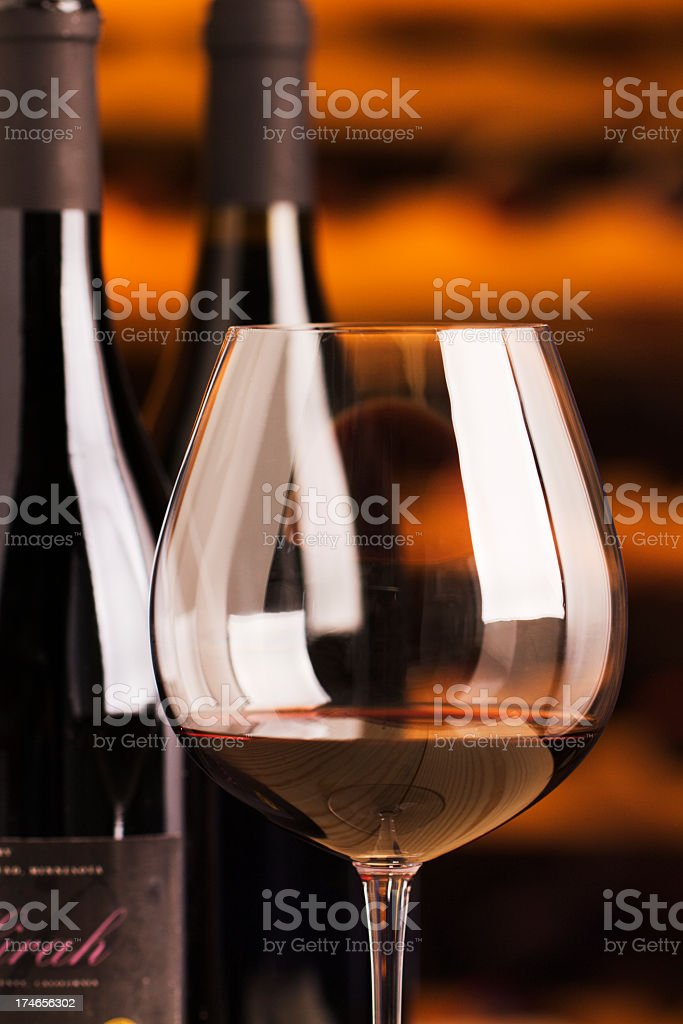 Winetasting Red Wine Glass Stemware and Bottles for Cellar Tasting royalty-free stock photo