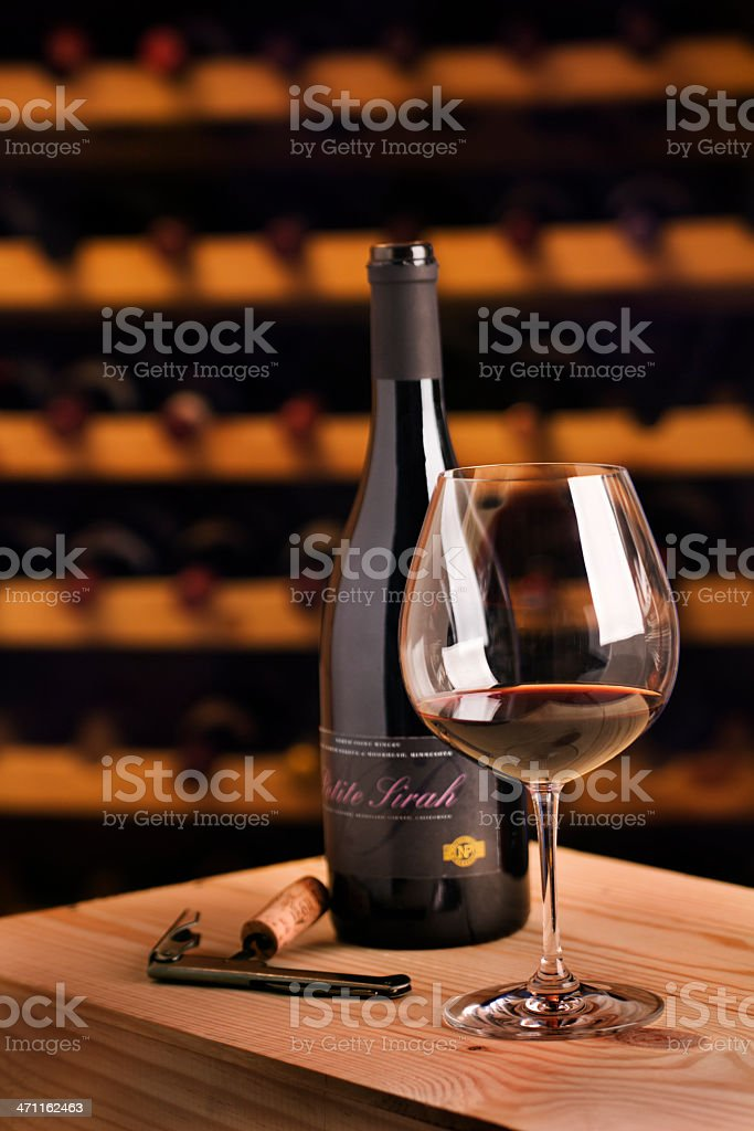 Winetasting Red Wine Glass with Bottle, Corkscrew for Cellar Tasting royalty-free stock photo