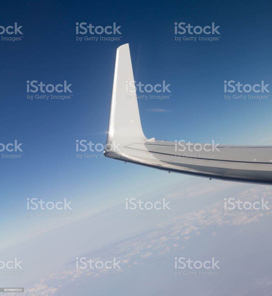 wing aircraft in flight stock photo
