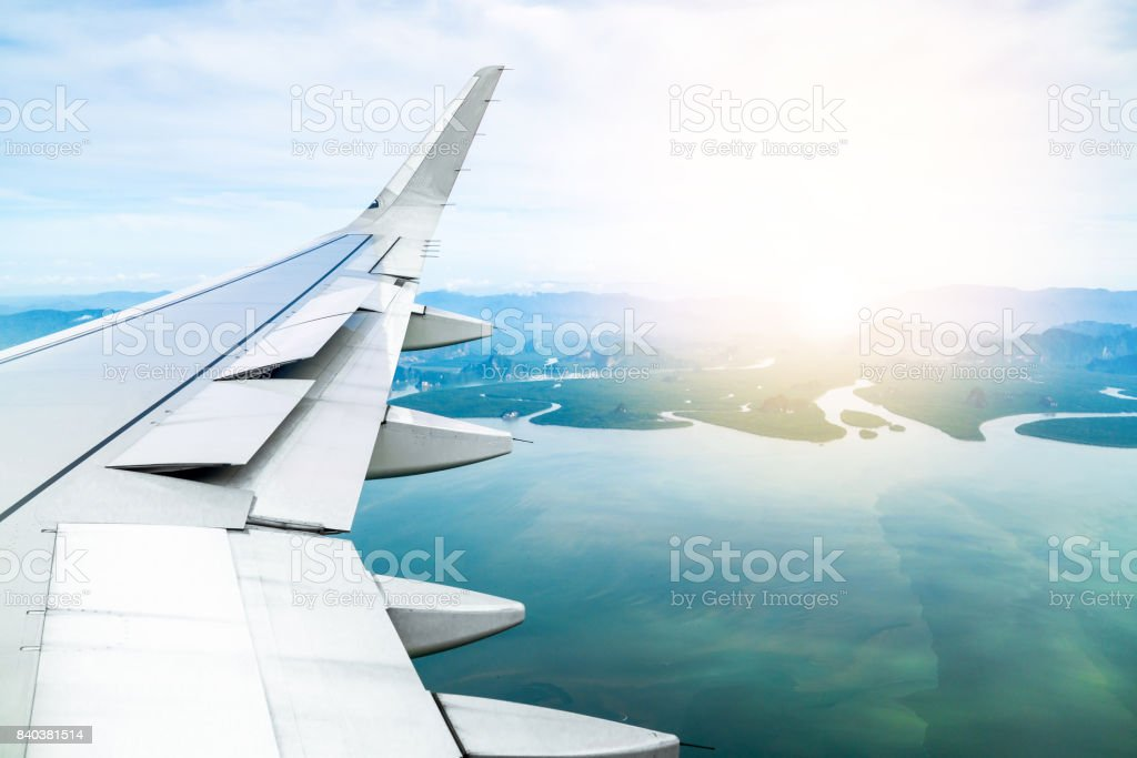 wing airplane, plane is fly on koh Phuket thailand, beautiful island background, copy space. stock photo