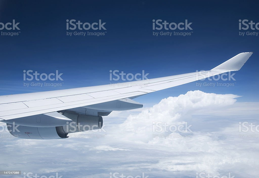 Wing and engine of passenger jet. royalty-free stock photo