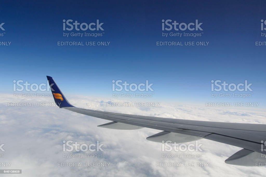 Wing detail in mid air of a Icelandair Boeing 757 stock photo