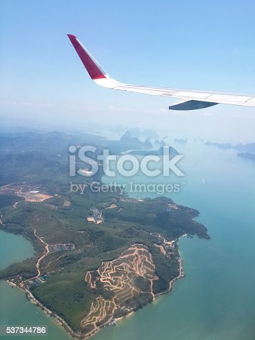 istock Wing of airplane flying above in the sky 537344786