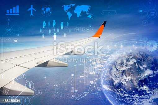 istock wing of airplane flying above the clouds in the sky 488535934