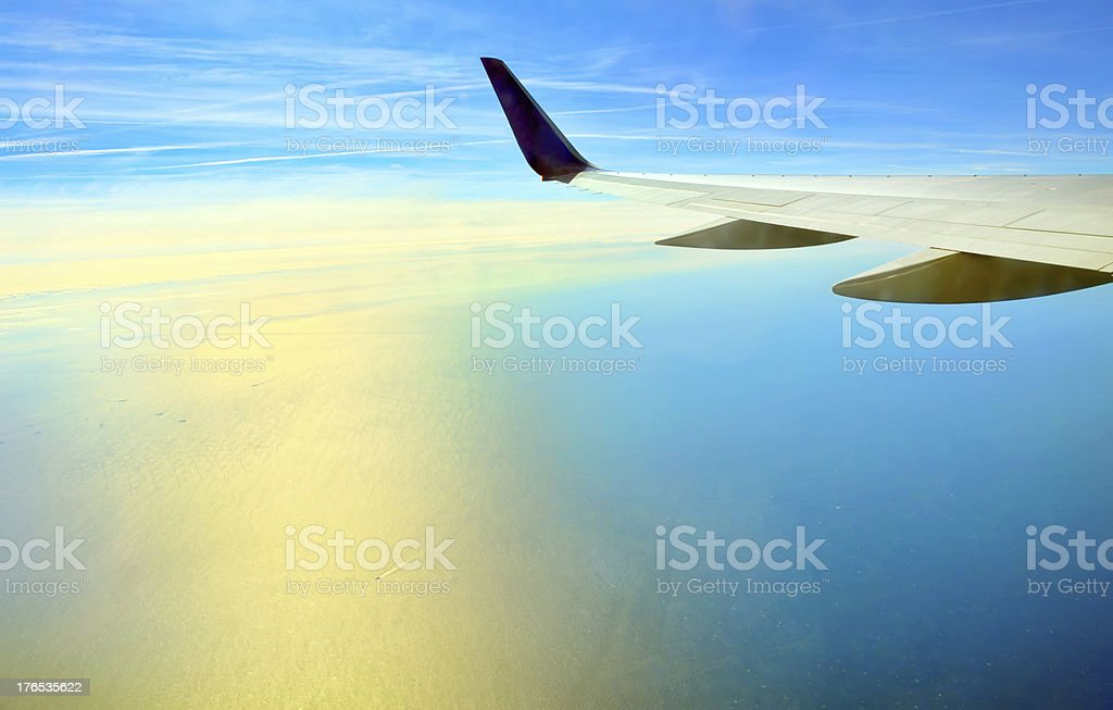 Wing of airplane flying royalty-free stock photo