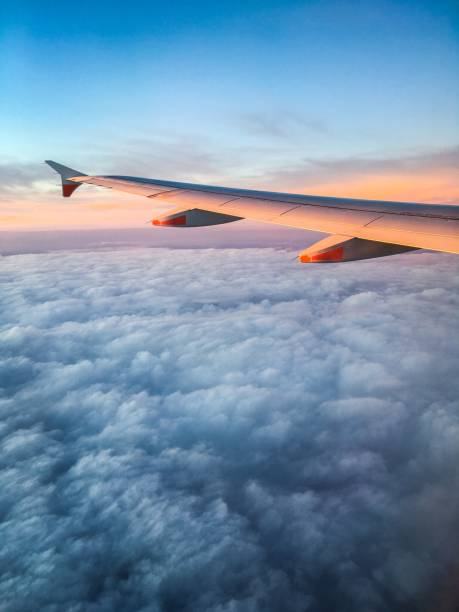Wing of an Airplane at Sunset stock photo